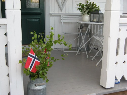 Norwegian Flags on porch