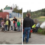 Kids lined up and trying hand at using firehose